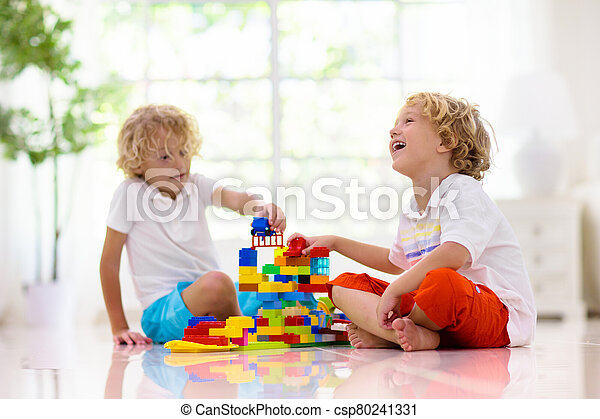 Child playing with toy blocks. Kids play. - csp80241331