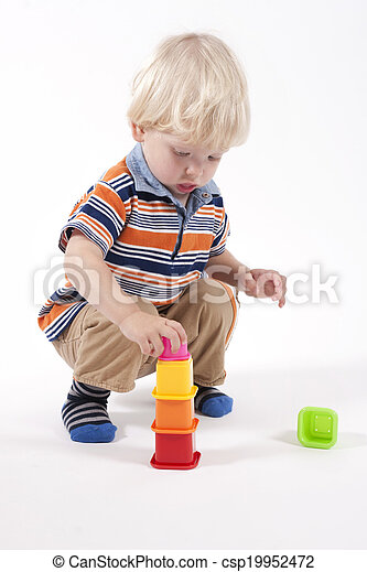 Child plays educational toy - csp19952472
