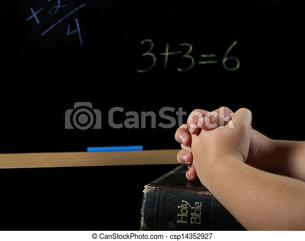 child praying in school - csp14352927