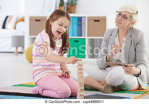 Child psychologist and school girl. Child psychologist during ...