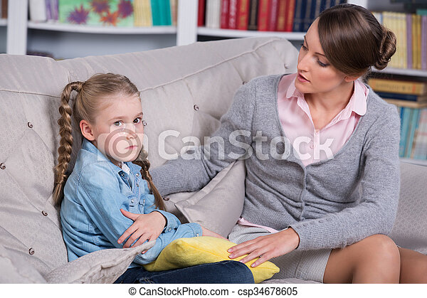 Child psychologist with a little girl, a child is crying.