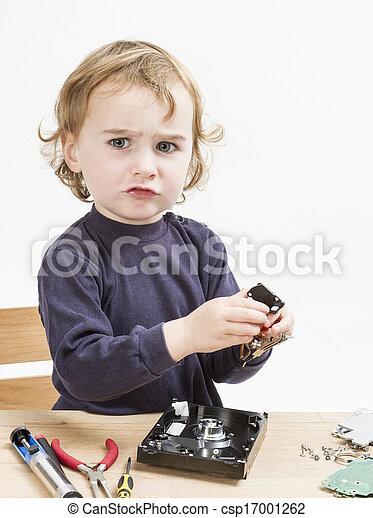 child repairing computer part - csp17001262