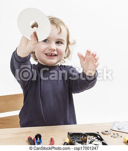 child repairing computer part - csp17001247
