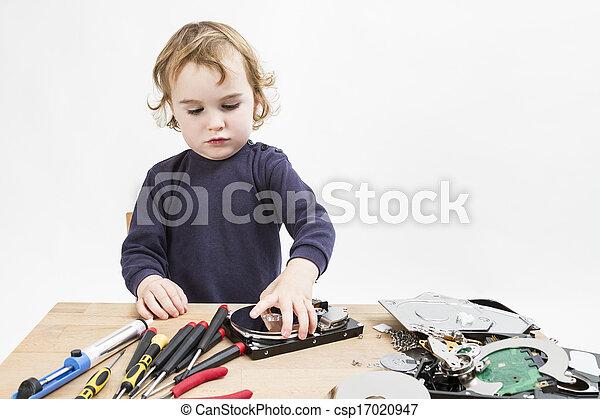 child repairing computer part - csp17020947