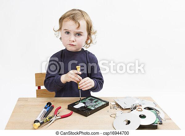 child repairing computer part - csp16944700