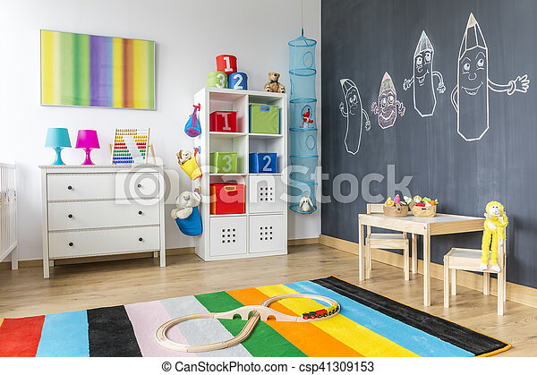 Child room with colorful rug - csp41309153
