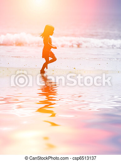 Child running at beach - csp6513137