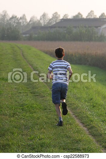 child runs along a country road - csp22588973