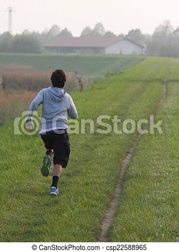 child runs along a country road - csp22588965