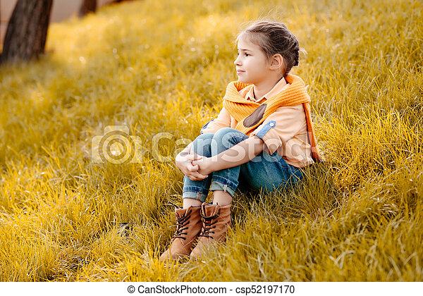 child sitting in park - csp52197170