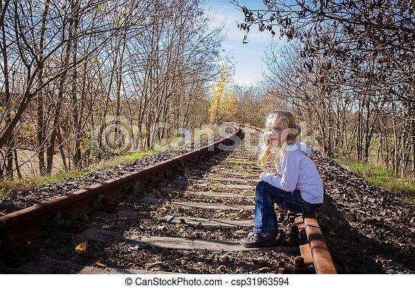 child sitting in railway - csp31963594