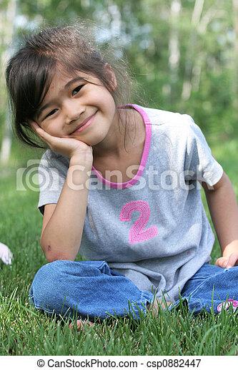 Child sitting on grass - csp0882447