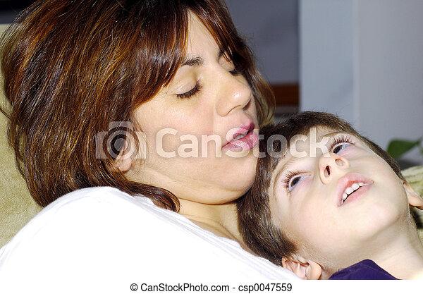 Child Sitting On Moms Lap - csp0047559