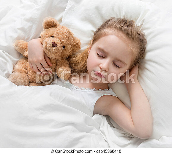 e4bab4e0dc7b Child sleeping with a cute teddy bear. Adorable child sleeping in ...