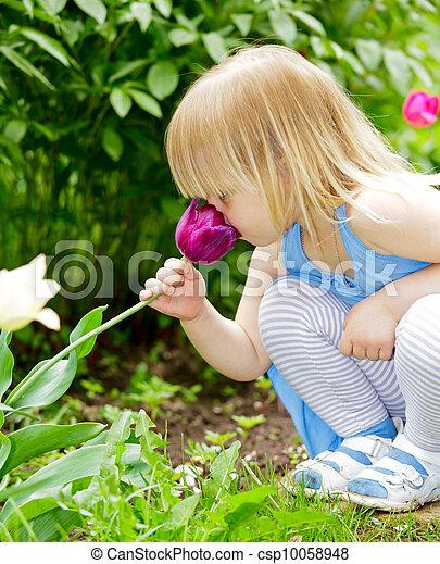 Child smelling flower - csp10058948