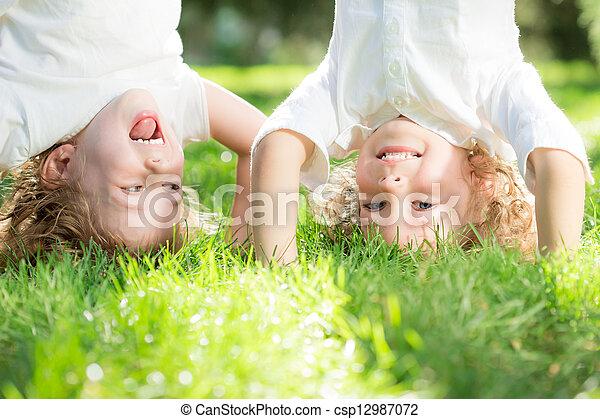 Child standing upside down - csp12987072