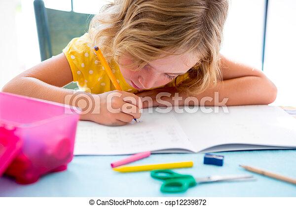 Child student kid girl writing with homework on desk - csp12239872