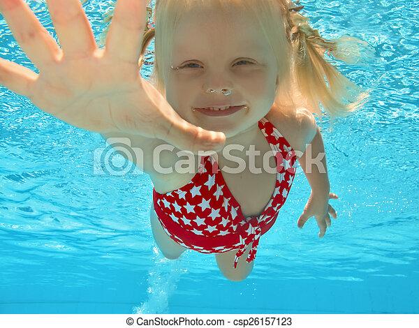 Child swimming underwater in pool - csp26157123