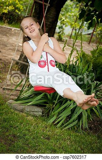 Child swinging on seesaw - csp7602317