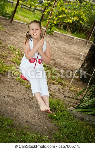 Child swinging on seesaw - csp7065775