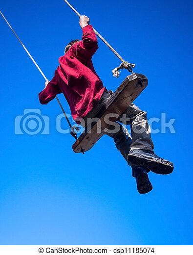 Child swinging on swing - csp11185074