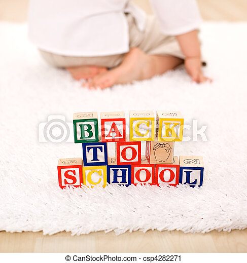 Child turning away from toy blocks - back to school theme - csp4282271