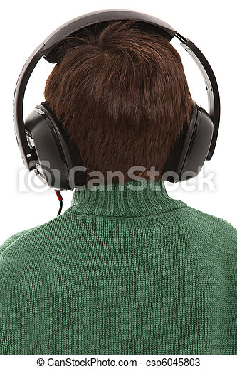 Child Wearing Head phones With Back Turned.  - csp6045803
