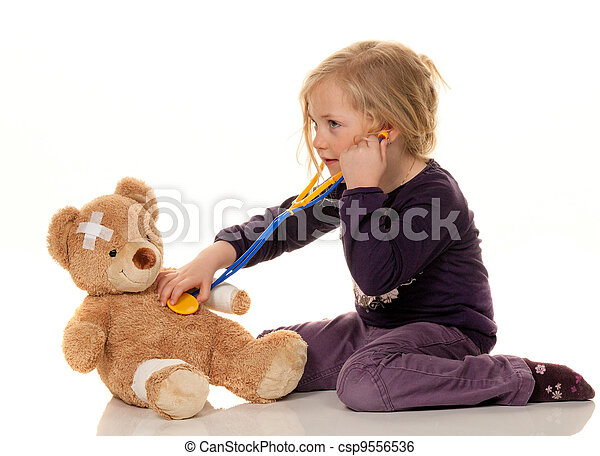 child with a stethoscope as a medical doctor. pediatrician examined patients - csp9556536