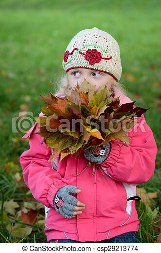 child with autumn leaves - csp29213774