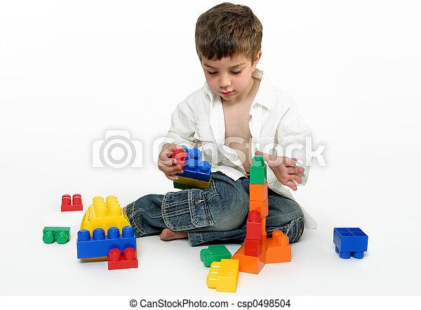 Child with building blocks - csp0498504