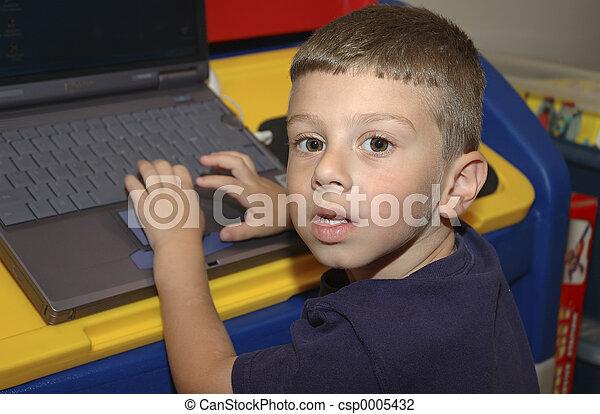 Child With Computer - csp0005432