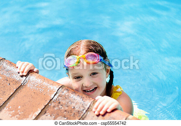 e6a0aaf10d Child with goggles in swimming pool. kids swim. Child with goggles ...