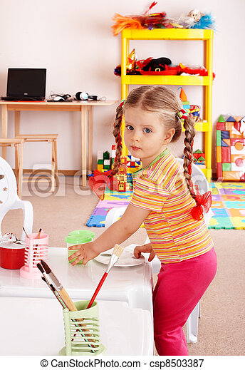 Child with paint and brush in playroom. - csp8503387