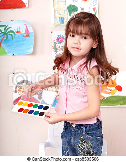 Child with paint  in art class . - csp8503506