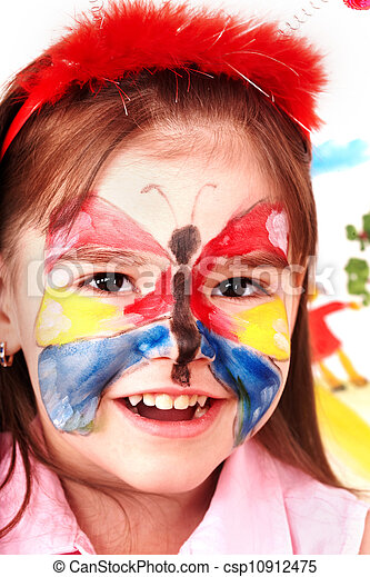 Child with paint of face in play room. - csp10912475