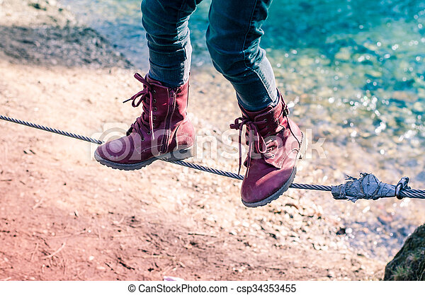 child with red shoes in rope - csp34353455