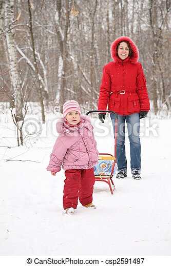 child with sled and mother in park at winter 2 - csp2591497