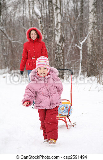 child with sled and mother in park at winter - csp2591494