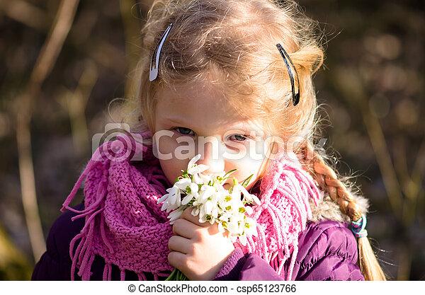 child with snowdrop flowers - csp65123766