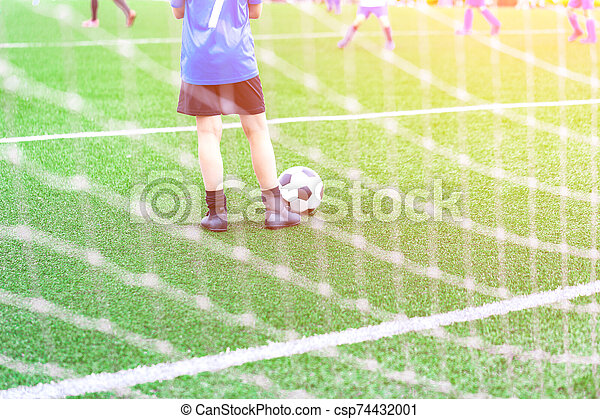 Child with Soccer ball at football grounds - csp74432001