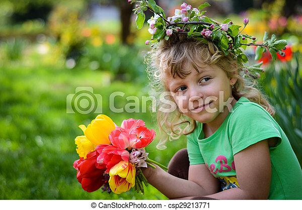 child with tulips - csp29213771