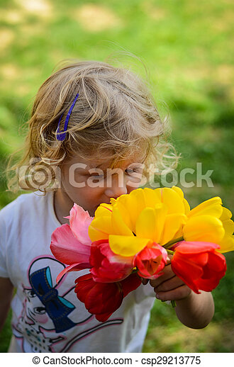 child with tulips - csp29213775