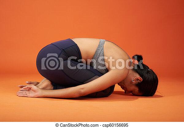 child yoga asana pose woman in child yoga pose on studio