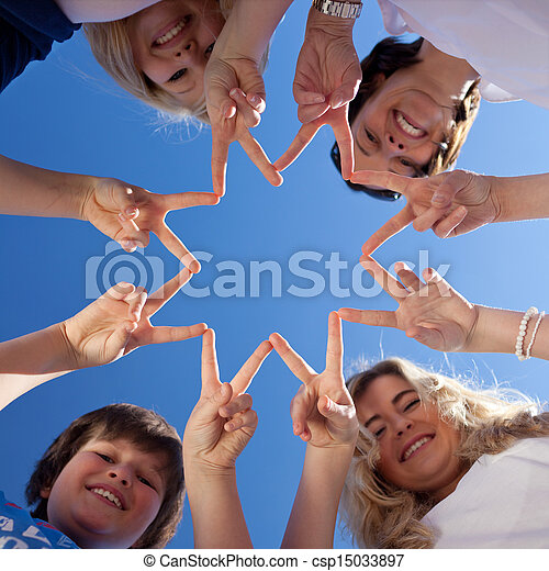 Children And Teacher Forming Star With Fingers Against Blue Sky - csp15033897