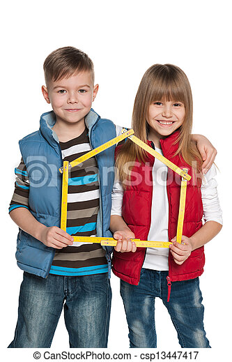 Children are holding model of a house - csp13447417