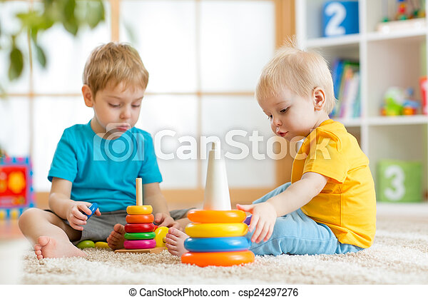 children brothers play together in nursery - csp24297276