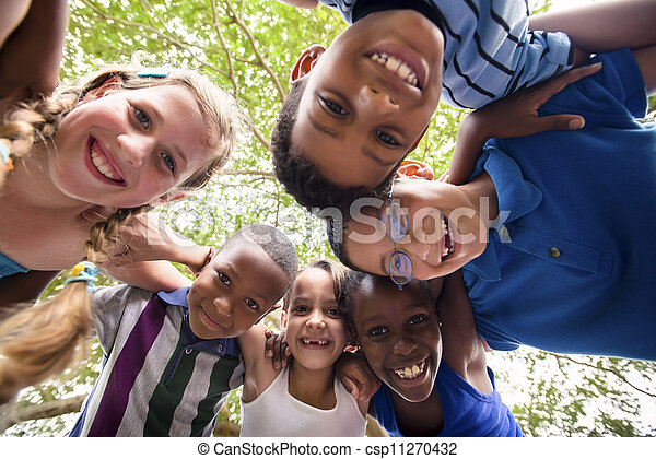 Children embracing in circle around the camera and smiling - csp11270432