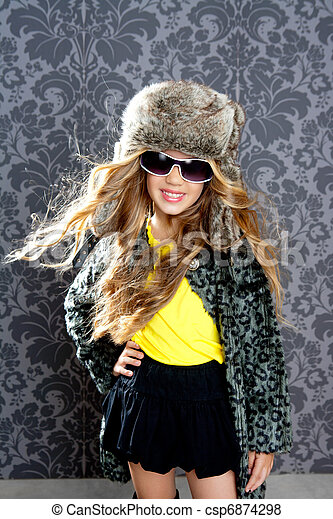 children fashion blond girl with fur winter coat and hat - csp6874298