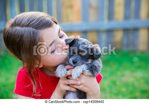children girl kissing her puppy chihuahua doggy - csp14309443
