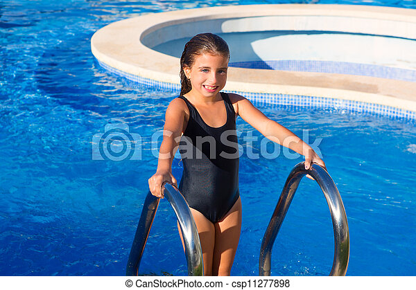children girl on the blue pool stairs black swimsuit - csp11277898